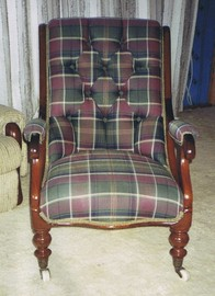 antique apholstered armchair after restoration