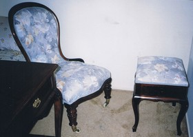 old armchair with cushion seat repaired